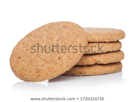 Stack of round organic crispy wheat and five grain salty crackers on white.  Stock photo © DenisMArt