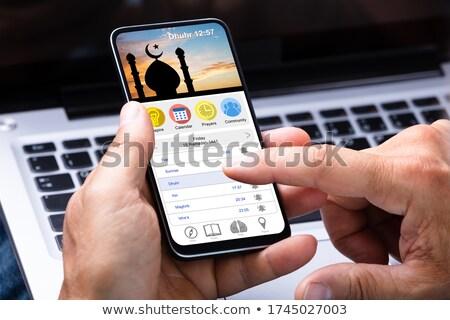 Hombre musulmanes oración aplicación teléfono móvil teléfono Foto stock © AndreyPopov