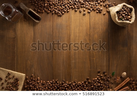 Coffee beans in glass jar on brown burlap stock photo © Ansonstock