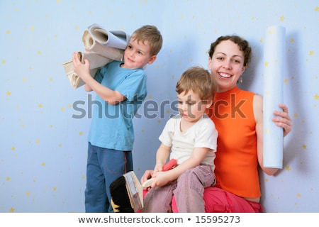 Children help mothrer to glue wall-papers Stock photo © Paha_L