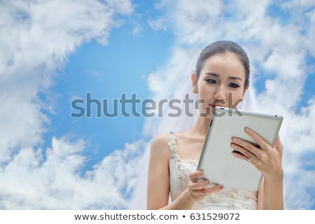 Young bride at blue sky background stock photo © Massonforstock