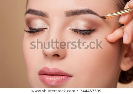 beautiful young model getting fashion make-up stock photo © Elmiko