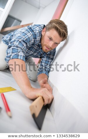 Man at home preparing to lay carpet Stock photo © photography33