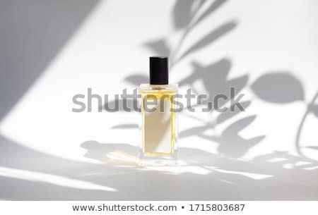 Perfume garrafa pérolas roxo seda flor Foto stock © hitdelight