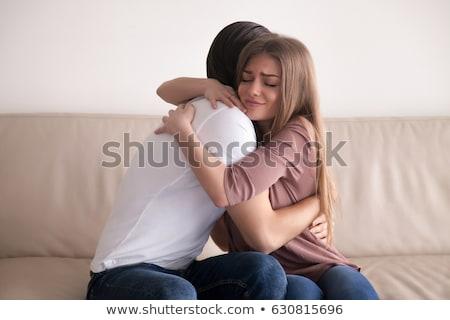 portrait of girlfriend boyfriend hugging each other stock photo © stockyimages