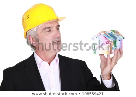 Grey-haired architect holding house made from bank notes Stock photo © photography33