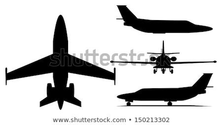 Faible avion silhouette noir gris isolé Photo stock © lkeskinen