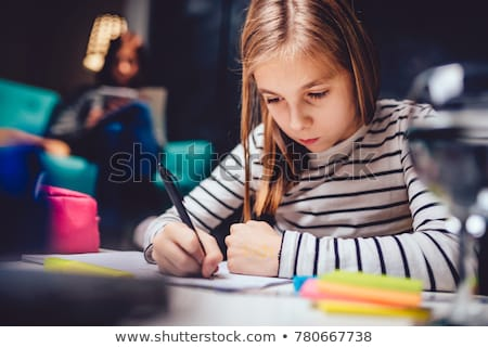 Two teenage girls writing on note pad Stock photo © photography33