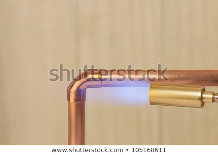 Man with copper pipe and a blowtorch Stock photo © photography33
