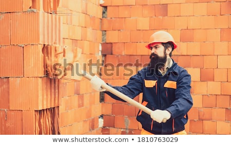 Builder about to smash wall Stock photo © photography33