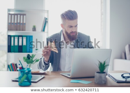 Businessman eating a yummy sandwich Stock photo © photography33