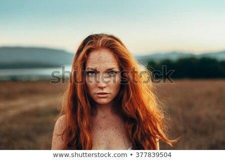 Lonely sad red-haired girl at field Stock photo © Massonforstock