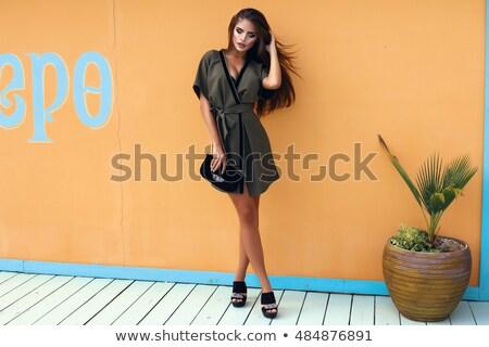jovem · feliz · mulher · amarelo · couro · calças - foto stock © rosipro