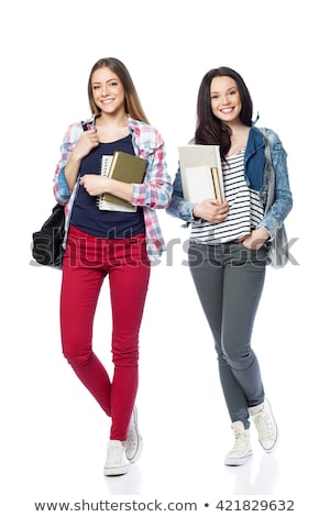 smiling young couple holding books posing to camera stock photo © get4net