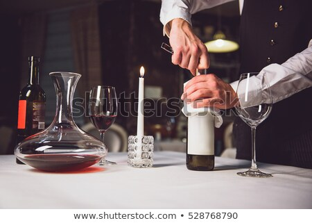 Man opening a red wine bottle  Stock photo © pedromonteiro