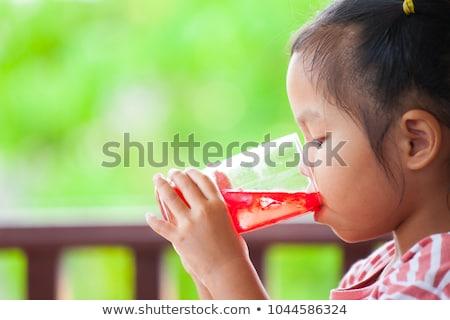cute · meisje · glas · sap · glimlachend - stockfoto © Len44ik