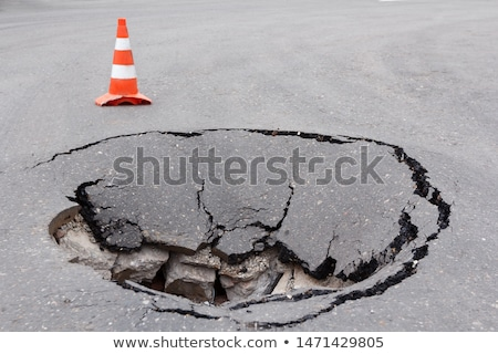 asphalt background with crack stock photo © kyolshin