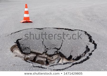 asphalt background with crack stock photo © kyolshin