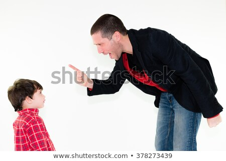 Angry father pointing finger at his child Stock photo © doupix