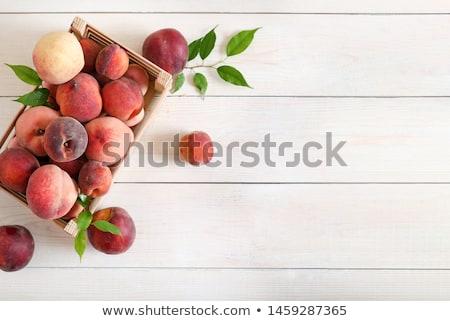 зрелый персики таблице листьев фрукты здоровья Сток-фото © inaquim