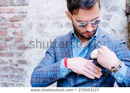 Fiatal üzletember megjavít zsebkendő mellkas zseb Stock fotó © feedough