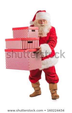 Santa Claus carrying stack of big Christmas giftboxes Stock photo © HASLOO