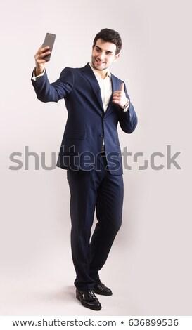 üzletember elvesz önarckép mobiltelefon portré férfi Stock fotó © stevanovicigor