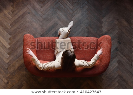 Woman in white suit and red sofa Stock photo © vetdoctor