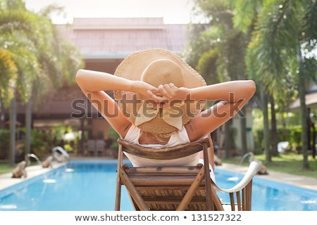 happy woman on a deck takes sunbathing Stock photo © ssuaphoto