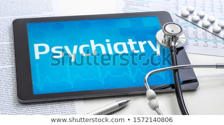 Tablet with the medical specialty Psychiatry on the display Stock photo © Zerbor
