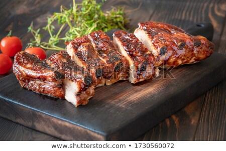 Cremalheira rústico carne de porco costela fechar Foto stock © zkruger