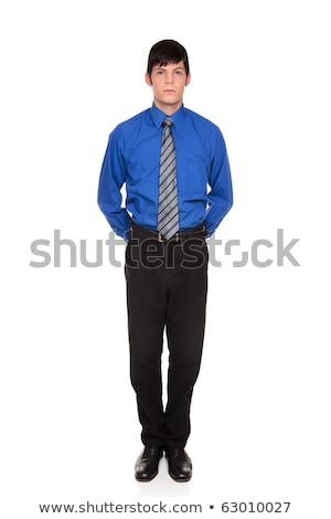 businessman standing with hands clasped behind his back Stock photo © dgilder