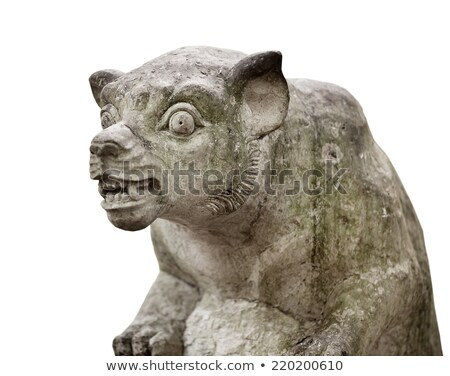 Muzzle of terrible mythical monster. Stone statue from Indonesia Stock photo © pzaxe