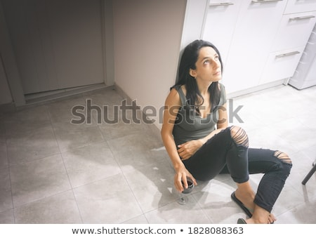 Depressed and sad woman in kitchen Stock photo © jiri_miklo