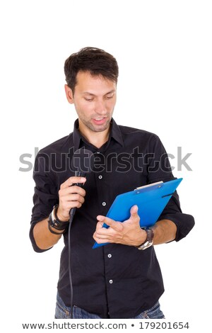 handsome man giving speech on microphone reading notes stock photo © feelphotoart