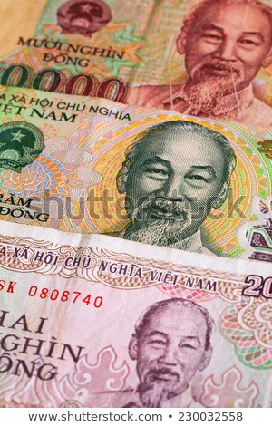 Different Vietnamese Dong banknotes on the table Stock photo © CaptureLight