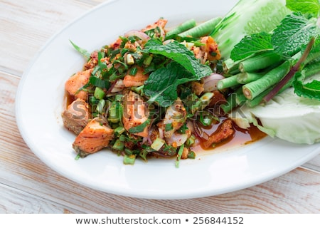 Spicy and sour salmon salad with vegetable and herb  Stock photo © nalinratphi