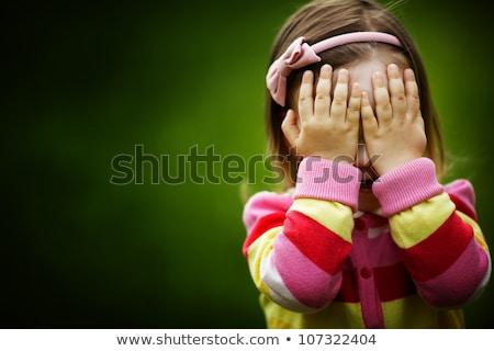 Félénk gyermek mosolyog kislány vicces arc kéz Stock fotó © Dave_pot
