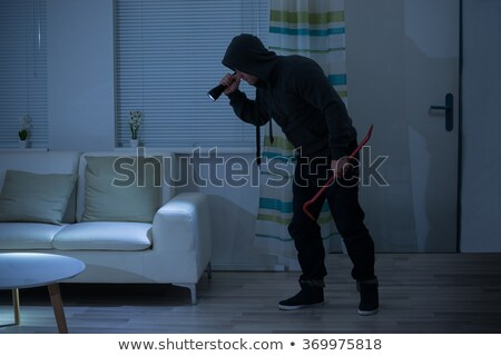 Thief Holding Crowbar In Living Room Stock photo © AndreyPopov
