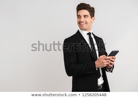 éljenez üzletember öltöny telefon fehér boldog Stock fotó © wavebreak_media