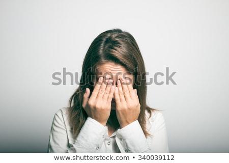 Nerveux femme blonde visage blanche femme mains Photo stock © wavebreak_media