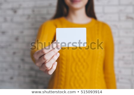 smiling girl with business card stock photo © stokkete
