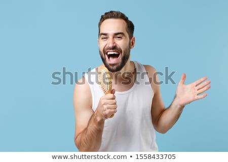 стороны синий рубашку микрофона изолированный Сток-фото © GeniusKp