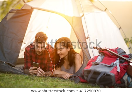 Couple using smartphone in the tent Stock photo © deandrobot