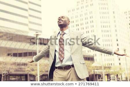 homem · de · negócios · terno · preto · amarrar · ao · ar · livre · branco · camisas - foto stock © ichiosea