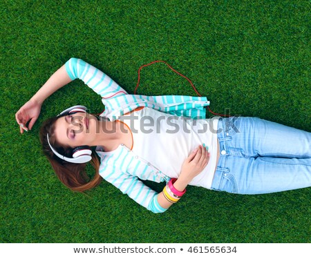 teenager lies on grass in headphones Stock photo © Paha_L