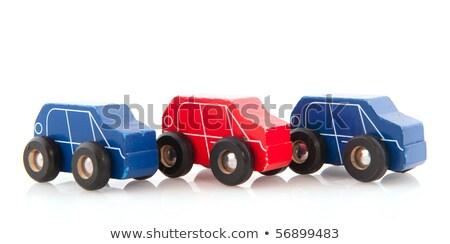 Três brinquedo de madeira carros simples branco Foto stock © Alsos