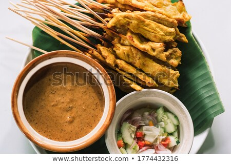 Pork Satay with Peanut Sauce and Cucumber Relish Stock photo © art9858