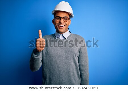 engineer wearing helmet and glasses showing thumbs up stock photo © feedough