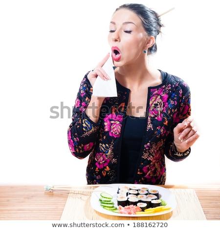 Nő ajkak szalvéta eszik kávézó néz Stock fotó © deandrobot